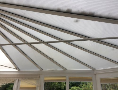 Conservatory with polycarbonate roof and front room bay window in Farnborough , Hampshire.